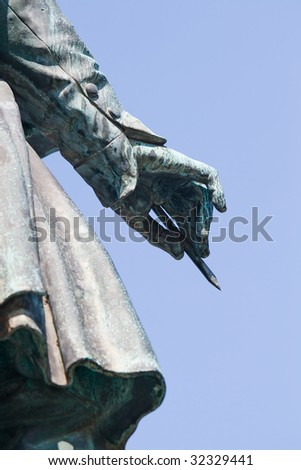 Beethoven Monument in Bonn. Focusing the right hand, holding a pencil. - stock photo