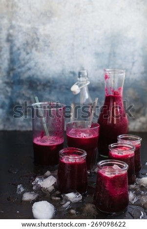 Beetroot and apple smoothies over dark  table. Summer food and drink  concept.