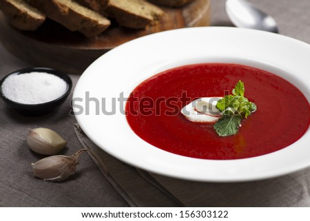 beetroot and tomato soup with ricotta and bread - stock photo