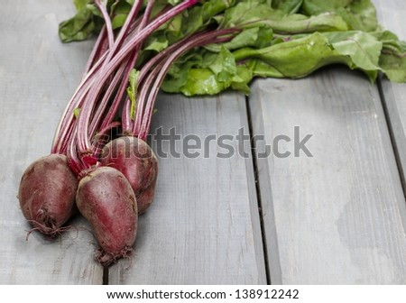 Beetroot on rustic wooden table - stock photo