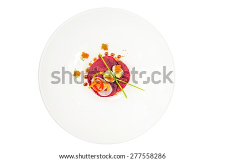 Beetroot salad with carrot, onion, potato, herring, garnish with mayonnaise, spring onion and dill - stock photo