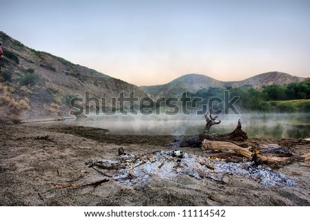 Before sunrise - smoke on awesome lake in mountains. Shot in the Langeberge highlands near Grootrivier river, Garden Route, Western Cape, South Africa. - stock photo