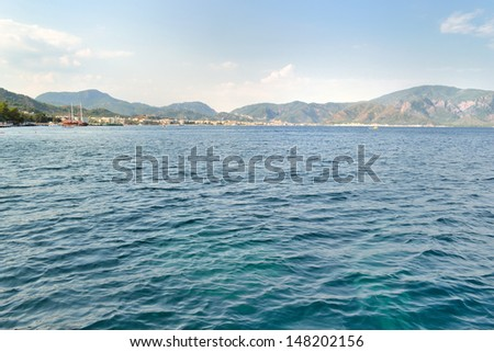 before sunset remote view of Marmaris town coastline - stock photo