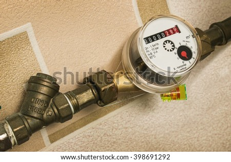 Before the water meter to the pipe fitted coarse filter - stock photo