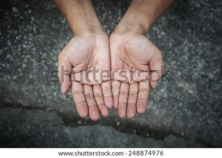 Beggar people and human poverty concept - person hands begging for food or help - stock photo