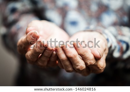 Beggar people and human poverty concept - senior person hands begging for food or help - stock photo