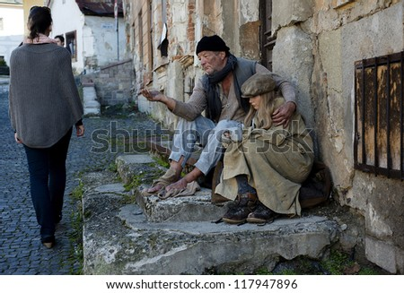 Beggars are begging for money on the street - stock photo