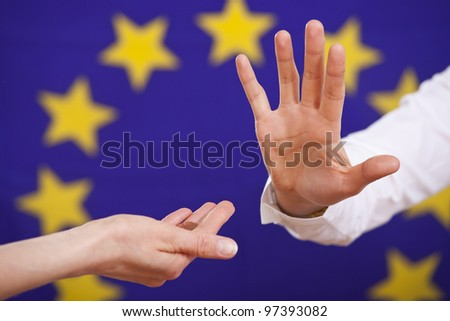 begging and rejecting hand over european flag - stock photo