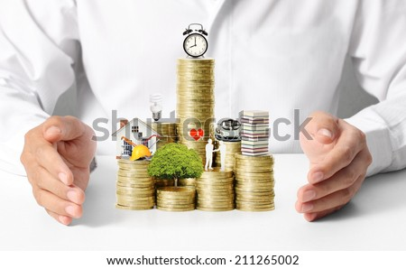 begin for mortgage concept by money house from coins - stock photo