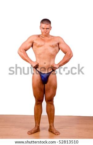 beginner Bodybuilder posing over white background - stock photo