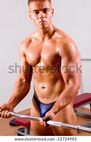 beginner Bodybuilder training in a gym - stock photo