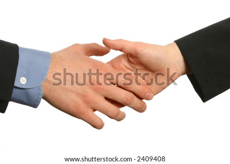 Beginning of a handshake, male and female hands in business attire - stock photo