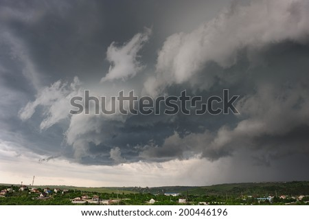 Beginning of the storm, cold weather front covers the village. Panorama stitched from 4 mages. - stock photo