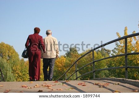 behind couple on autumn bridge - stock photo
