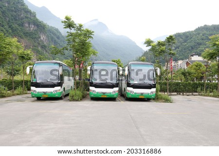 BEICHUAN,CHINA - 28 June,2014:green travel bus before the BEICHUAN earthquake  tourist center.