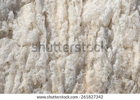 beige background frozen river foam - stock photo