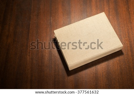 Beige book on the table - stock photo