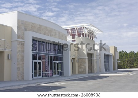 beige, brown and white strip mall with stone accents - stock photo