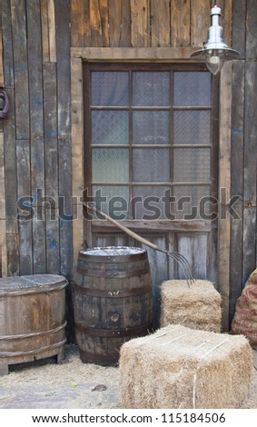 beige brown haystack wheat yellow Casks lights doors - stock photo