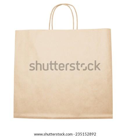 Beige brown kraft paper bag with handles - stock photo