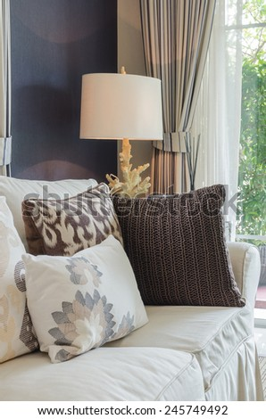 beige color sofa and pillows in living room at home - stock photo