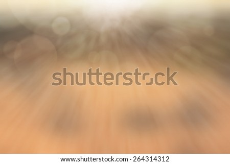 Beige Color with light rays and blurred background - stock photo