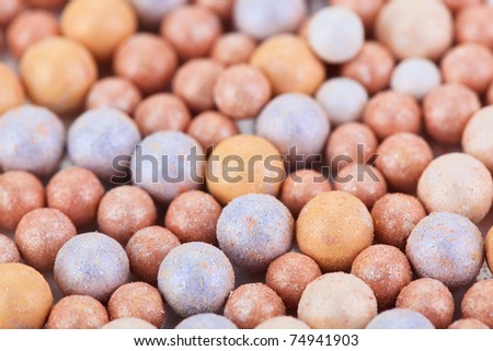 Beige cosmetics multicolor rouge balls background, macro view - stock photo