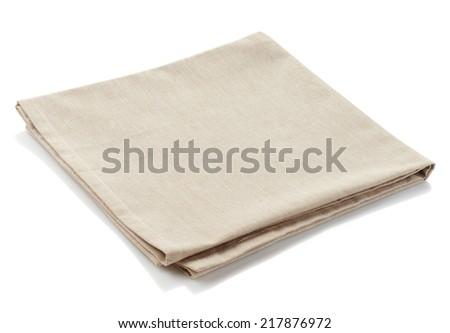 Beige cotton napkin isolated on white background - stock photo