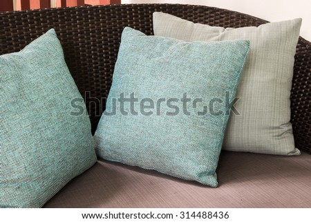 Beige cushions on couch - stock photo