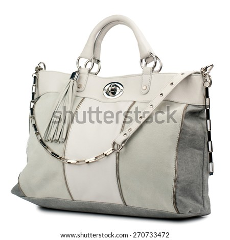 Beige female handbag isolated on white.