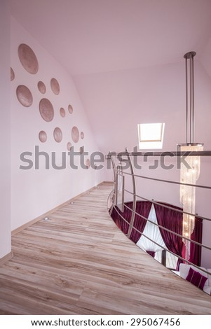 Beige floor panels in unfurnished empty hall - stock photo