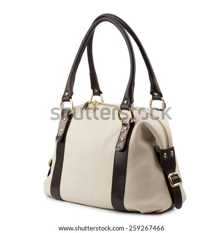 Beige handbag with brown handles isolated on white.