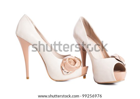 Beige high heel shoes isolated on white - stock photo