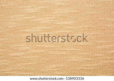 Beige knitted texture.