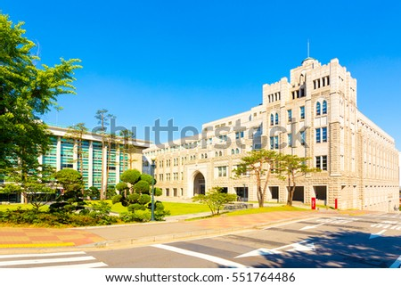 Beige Law School building on the campus of Korea University on a sunny, blue sky day in Seoul, South Korea