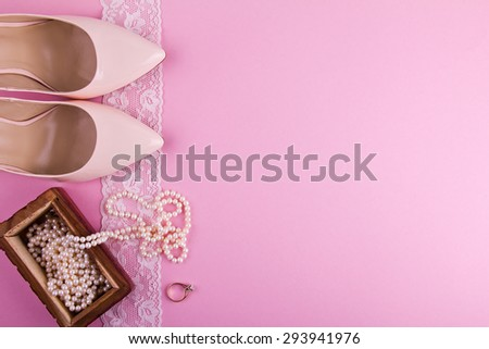 Beige leather shoes with high heel and accessories on pink background. Place for your text. Wedding, engagement theme. Good for blogs, instagram. - stock photo
