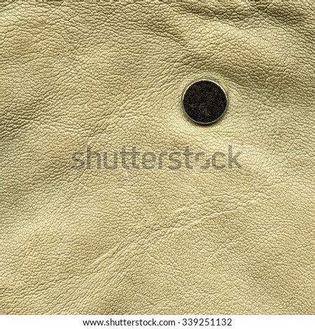beige leather texture decorated with button