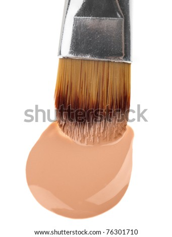 Beige liquid foundation makeup stroke with brush, isolated on white - stock photo