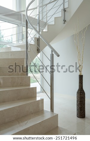 Beige marble stairs inside the apartment - stock photo