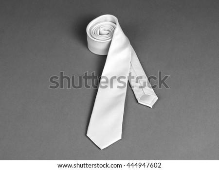Beige necktie on gray background - stock photo