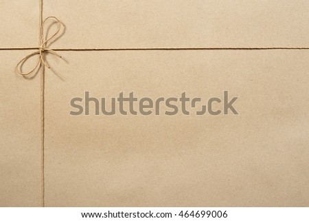 Beige packing paper, paper tied with a rope