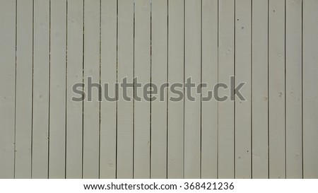 Beige Painted Wooden Fence Background.  Ideal for fashion or music background, poster or street sign. - stock photo