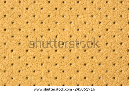 Beige Perforated Artificial Leather Background Texture - stock photo