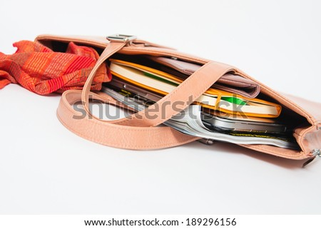 Beige Pink Bag with Content Spilling out Showing Make up, Red Scarf, Notebook, laptop and Magazine