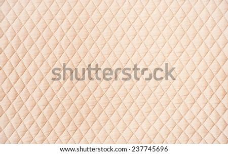 Beige quilt background - stock photo