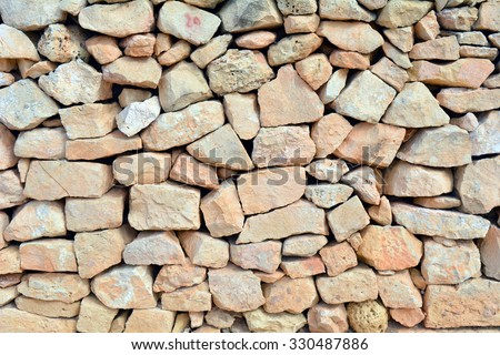 Beige rocks wall. - stock photo