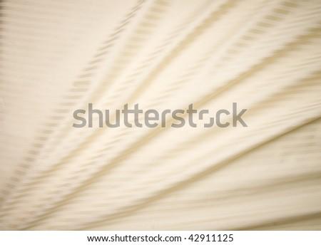 beige satin silky sheets - stock photo