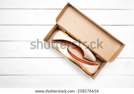 beige shoes flats in a box on a white background - stock photo