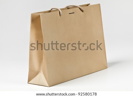 Beige shopping bag on white. - stock photo