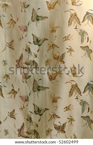 Beige silk sheet as background, Chinese shop